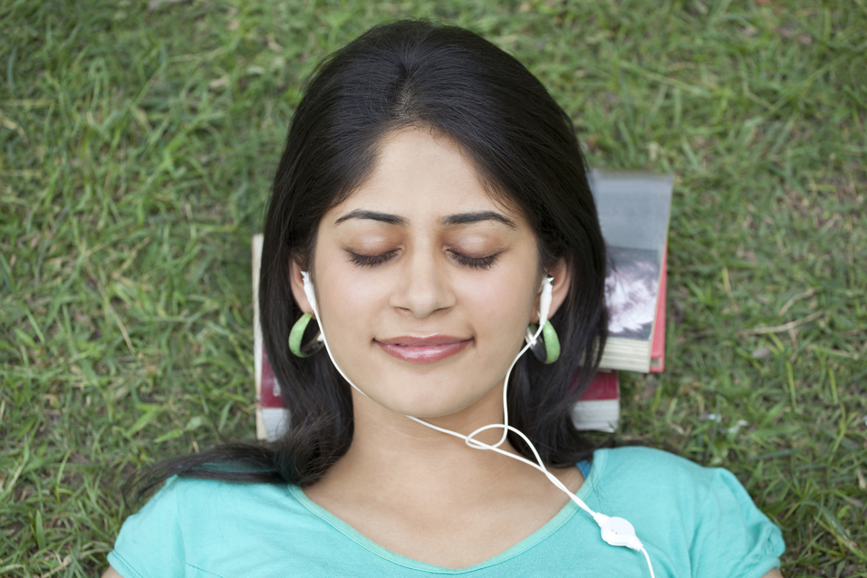 woman listening to a podcast