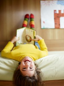 A child enjoying her book
