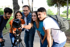 group of young photography students with teacher during an outdoor photo course