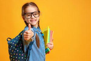 funny child school girl girl on yellow background