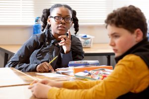 A sixth-grade student contemplates the meaning of her math lesson. <br /> <strong>Photo by Allison Shelley for American Education: Images of Teachers and Students in Action</strong>