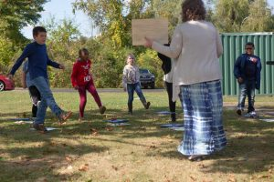 Third-grade students dance during an outdoor socially distanced music class. <br /> <strong> Photo by Allison Shelley for American Education: Images of Teachers and Students in Action </strong>